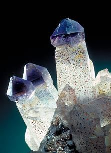 Quartz:amethyst Resembling a monarch's scepter, this type of growth oddity is called scepterism. This specimen shows amethyst-topped rock crystal quartz. This happens when a second crystal (the amethyst) grew on top of the clear rock crystal after the rock crystal has stopped growing.