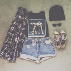 Black, graphic muscle tee paired with high waisted, distressed, denim shorts and a black and white plaid flannel. Accessories include a black beanie, gray converse, and black sunglasses.