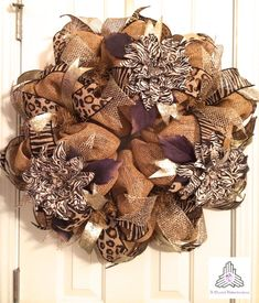 Hey, I found this really awesome Etsy listing at http://www.etsy.com/listing/173750159/burlap-animal-print-deco-mesh-wreath