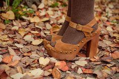 Close-up of brown tights in cognac velvet heels