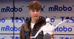 justin bieber funny faces | Scene Everywhere: Justin Bieber Introduces mRobo - J-14 Magazine