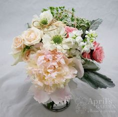These hung from shepherd hooks along side the aisle. Blush Peonies, white scabiosa, white stock, pink spray roses, Queen Ann's Lace, Dusty Miller Flowers By April's Garden http://www.durangoflorist.com/