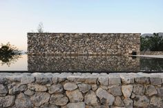 Flint, Stone, and Pebbles: Buildings That Marry Traditional Craftsmanship With Modern Forms - Architizer