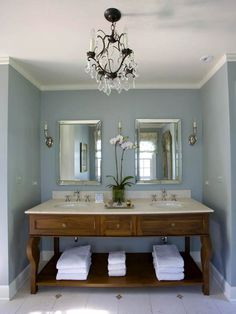 Elegant enough to be a master bath but not pretentious enough to destroy the calming effect could describe the view upon entering this room.  Add a gorgeous  claw foot tub on the right and a walk in shower to the left with a commode and another piece of furniture for storage and the room is complete.  If you wanted to make the room a little more casual, consider painting the furniture red.