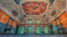 """Polish photographer Patrycja Makowska takes incredibly detailed shots of ruined buildings but refuses to divulge their location. This image, titled """"Memories of Days Gone By"""" contrasts the unreal aquamarine and copper color scheme of the elaborate interior with the bri..."""