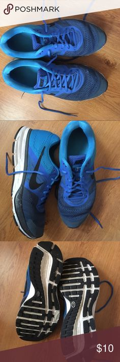 Nike Pegasus 30 men's tennis shoes This multi colored blue Pegasus 30 men's tennis shoes are known for their support and fashion. Signs of wear and tear are evident, but can still do their job! Nike Shoes Athletic Shoes