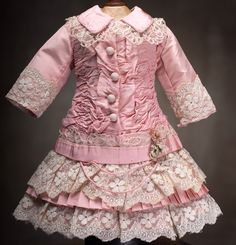 Antique Pink dress-inspiration for AG doll, lace trimmed sleees, button flap, rouched drop waistline, ruffle on front of bodice, band on  bottom of jacket, ruffled two tiered skirt with lace trim, appears to be a satin jacket