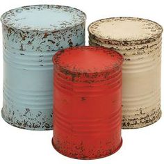 "Three distressed metal drum end tables.    Product: Small, medium and large side tableConstruction Material: MetalColor: Distressed blue, red, and ivoryDimensions: Small: 16"" H Medium: 18"" H Large: 20"" H"