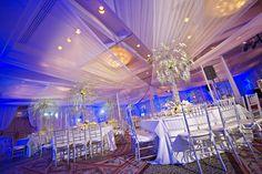 White winter wonderland wedding reception decor | Photo: Focused on Forever Studio