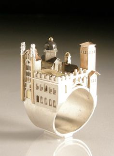 "Vicki Ambery-Smith's jewellery are finely detailed interpretations of buildings from all over the world. http://www.vickiamberysmith.co.uk/index.html  ""Cambridge Ring"" by Vicki Ambrey-Smith"