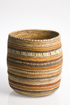 Image from ReCoil: Change and Exchange in Coiled Fibre Art National Museum of Australia 15 November 2008 – 14 June 2009  Courtesy Elcho Island Arts & Crafts. Photo: Peter Eve, Monsoon Studio.  Pandanus (Pandanus spiralis), natural dyes, natural pigments, fibre string.