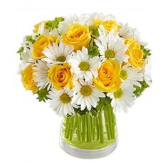 A bouquet of yellow roses and white daisies in a glass vase. Available for delivery across South Africa!