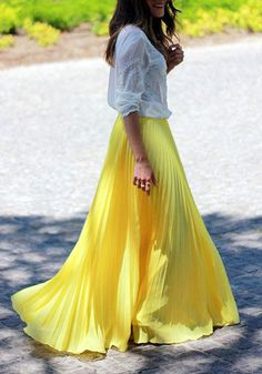 This yellow pleated maxi skirt is styled with accordion pleats and elastic waistline.