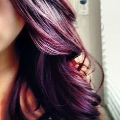 Purple and red highlights with dark brown hair.