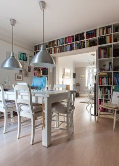 Henriette's Artistic European Abode — House Tour --> very much to my liking. White. Art. Clean but not precise.