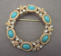 Signed Crown Trifari Circle Pin with Faux Turquoise and Rhinestones 1960s by thejeweledbear on Etsy