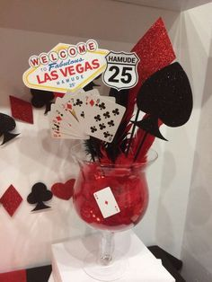 Red and black centerpieces at a Las Vegas birthday party! See more party planning ideas at CatchMyParty.com!