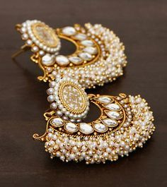 Style yourself with this elegant pearl embellished traditional earrings to your ethnic look. Indian Wedding Jewelry, Bridal Jewelry, Gold Jewelry, Jewelry Accessories, Jewelry Design, India Jewelry, Ethnic Jewelry, Trendy Jewelry, Traditional Earrings