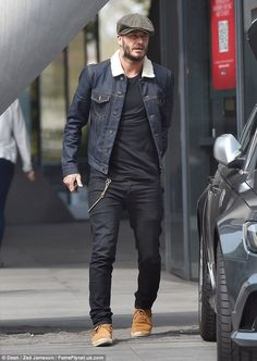 David Beckham worked the outfit: skinny jeans, fringed moccs, hat & beard!