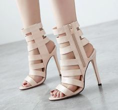 - Sexy beige bandage open toe ankle zip stiletto heels for the trendy woman - Stylish cage offers a unique trendy look - Side zip for easy access - Great for parties or social events - Made from PU -