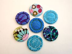 Here's another handmade button with a long history. Singleton buttons are easy to whip up and a great way to use those precious scraps of pretty fabric.