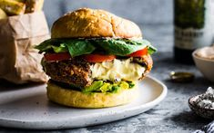 Two Portobello mushrooms stuffed with melty cashew cheese, coated in panko bread crumbs and fried until crispy then sprinkled with rosemary salt. Layered on a toasted burger bun with a spicy cashew mayo, avocado, tomato, lettuce, and pickles if you're feeling it.