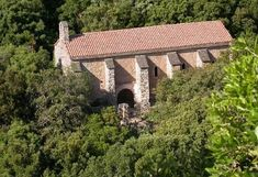 L'Eglise du Trou, reached by a footpath from the vineyards of Gimios