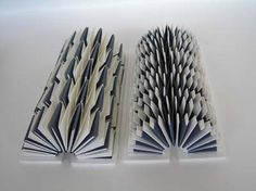 Textes Textures by Helen Malone. 2010. The textured blue and white 3D surfaces of these opened sculptural books comprise abstract texts integrated with the pages, the structure being based on concertina folds. Fabriano and Canson paper. Sculptural artists book. 18 cm x 3 cm x 4 cm.