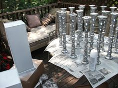 Harlow & Thistle: DIY Wedding Centerpieces  she used 6 inch silver mixing bowls from dollar store, sent to florist to fill with flowers, then affixed the bowls to the candlesticks with floral tac   can spray paint any color