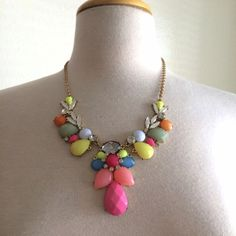 Pastel necklace Gorgeous necklace! It has lots of pastel colored gems. It has a gold chain. It's missing on little chain ring (see pic 3). It doesn't affect the integrity of the necklace. Jewelry Necklaces