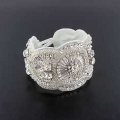 Scalloped Applique Bracelet - Add unique style and rich detailing to your look.  Intricate prong-set crystal, seed & bugle bead patterning.