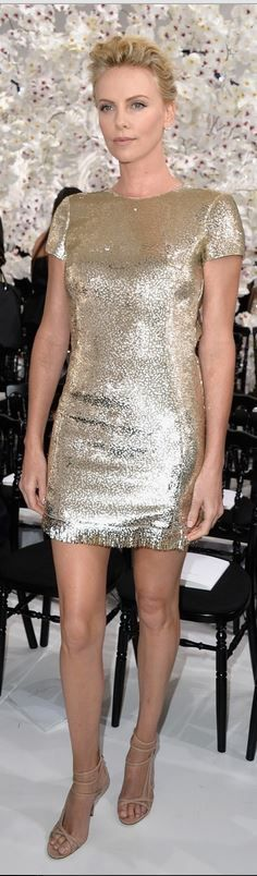 Who made Charlize Theron's gold short sleeve dress, jewelry, and nude sandals…