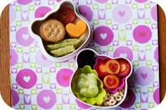 I love Bento lunches for the kids.  I try this as best I can, but don't have time for the cute junk like caterpillars and making favorite things out of food.  I like the simple and I can dig the cookie cutter shapes.