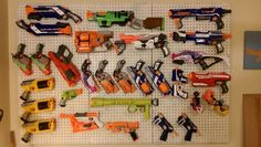 This is my pegboard wall. There are many like it, but this one is mine. Nerf Rifle, Nerf Gun Storage, Sweater Making, Kids House, Playroom, Kids Room, Toys, Wall, Room Layouts