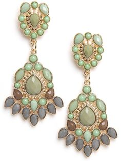 A rich mix of warm-tone cabochons keep bold statement earrings just right for day.  Acrylic cabochon stones in mixed green hues, brown, and gray are arranged into two burst patterns.
