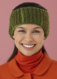 Keep your ears snug and forehead snug and warm under this colorful crocheted earwarmer. Each side of this project widens to make a close-fitting and convenient ear flap. (Lion Brand Yarn)