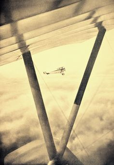 A view of a biplane from another biplane.  L'Illustration Newspaper, photographer unknown, ca. 1915, French aircraft on patrol during the First World War