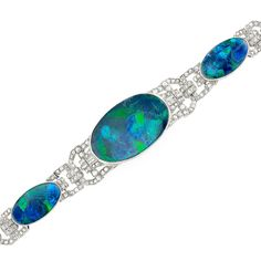 Platinum, Black Opal and Diamond Bracelet  One oval opal ap. 36.50 cts., 2 oval opals ap. 16.50 cts., rose-cut diamonds, 6 baguette diamonds, ap. 28 dwts. Length 7 inches.
