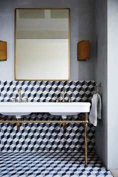 Bathroom with Geometric Tiles in Modern Bathroom Ideas. A modern bathroom with geometric tiles in a white, yellow and blue colour scheme. Bad Inspiration, Bathroom Inspiration, Interior Inspiration, Bathroom Ideas, Bathroom Makeovers, Bathroom Wall, Master Bathroom, Brown Bathroom, Bathroom Lighting