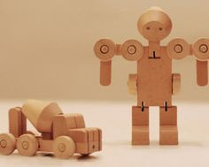 Transforfun's wooden robots. No vehicles! Or maybe robots? No matter how you look at them, it's a toy that let's you turn a car or boot into a robot.