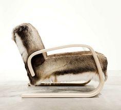 Alvar Aalto's Artek Armchair 400 upholstered in reindeer skin