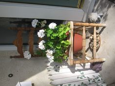 Old chair used as planter, just drop a potted plant in that does not fall through and you are done.