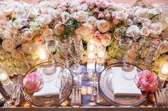 Lush blush roses and glassware and china from @classicparty adorned the tablescapes. (Decor: @revelryeventdesign @revelrymatias |Venue: @bevhillshotel | Planner: @internationaleventco | Florist: @marksgarden @michael_marksgarden | Photographer: @Dukeimages| Band: @vikmomjian | Linens: @wildflowerlinen | Rentals/Dance Floor: @harryspartyrental | Wedding Cake: @cakestudiola | TableTop Rentals: @classicparty |  Lighting: @thelightersidela)