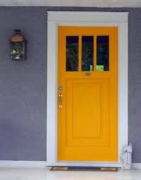 For an affordable exterior upgrade, paint your front door an unexpected shade, like pumpkin-orange or chartreuse-green. The result: a happy punctuation point that modernizes an old house yet doesn't compromise its historic character. Bright Front Doors, Orange Front Doors, Yellow Doors, Front Door Colors, Front Door Decor, Orange Door, Front Porch, Door Paint Colors, Exterior Paint Colors For House