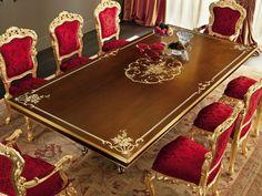 mesa preciosa y sillas rojas para el comedor moderno