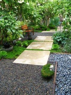 lush greenery, concrete and rocks