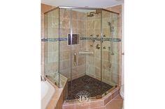 This Glass Shower door has:    Neo Angle Shower   Frameless Shower Doors   Brushed Nickel Finish   Clear Glass   Hera Handle   Hera Style   Pivot Hinge   header   Wall Mount Clamp