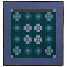 Nine-Patch Amish Quilt (circa 1940) - part of the former Esprit Collection. At the time of original publication (December 2007), it was preserved and displayed at the Lancaster (Pennsylvania) Quilt & Textile Museum.