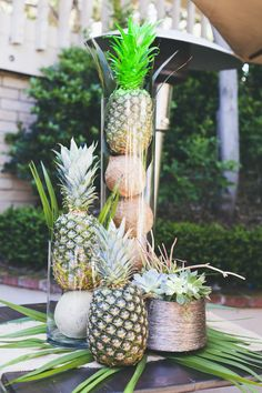 Event produced by Kapture Vision. outdoor, summer, table setting, centerpiece, pineapples