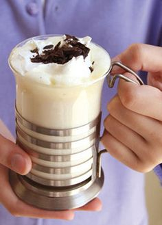 Snow White Cocoa::  2 c. whipping cream,   6 c. milk, 1 tsp. vanilla extract and 12 oz. white chocolate chips. Heat all in a crockpot on low for 2-3 hours. Pour into mugs and garnish with whipped cream and dark chocolate curls.